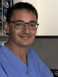 Dr Tariq Ahmad Exeter Gut Clinic Consultant gastroenterologist in scrubs Royal Devon & Exeter Hospital